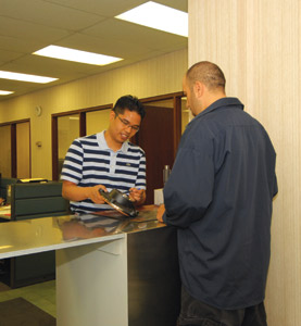 Offer younger employees assignments outside their normal sphere to keep them challenged. Here, a part sales representative sells a part to a walk-in customer at Mascot Truck Parts. (Photo by Jim Park)