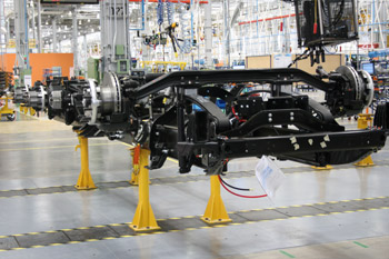 As truck manufacturing gets increasingly global and the costs for new components spiral, chassis like this Freightliner being assembled in Saltillo, Mexico, carry an increasing number of in-house components. (Photo by STF)