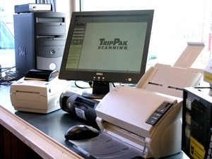 Software companies have developed ways to convert documents into electronic format as close to delivery as possible. Above is a TripPak scanning station at a truckstop.
