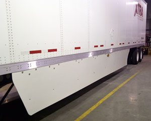 Laydon's Hybrid skirt used simple extruded plastic panels, strong and flexible spring struts, and molded mono clamp to attach the devices to trailer crossmembers.