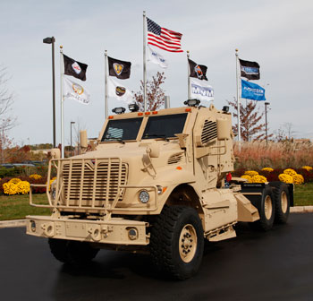 Like armored MRAP trucks, the new MaxxPro tractor is based on International's WorkStar civilian vocational series.