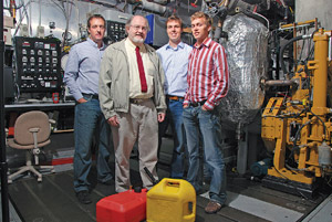 Rolf Reitz, center, and his team of graduate students in the engine research group.