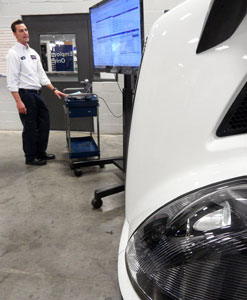 J.D. Marshall, dayshift shop foreman at Nacarato Volvo Trucks in LaVergne, Tenn., demonstrates how the Volvo Assist system ties together all pertinent data on a truck to aid in quick diagnosis and servicing.