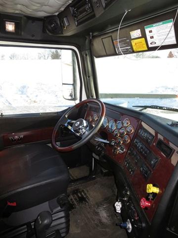 Premium interior features bright-metal trim around the 17 gauges,