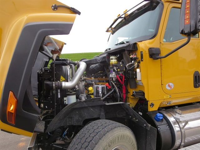 The 430-hp Cat CT13 (aka Navistar N13) diesel is painted Cat yellow,