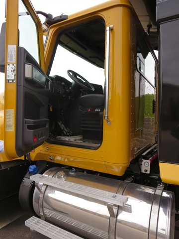The aluminum cab sports cowl-mounted mirrors that give steady views to
