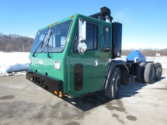 The cab sits low and well forward of the steer axle. One step and the
