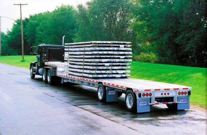 The lower main deck of this lightweight aluminum drop-deck trailer can