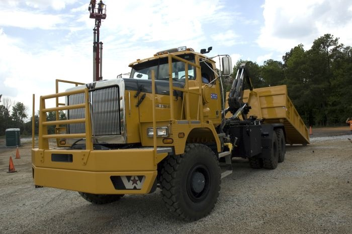 Western Star's new 6900XD, hooked to a SmithCo 70-ton side dump