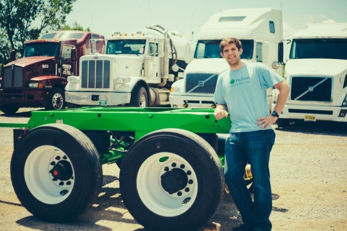 Hyliion founder Tom Healy poses with the first prototype of the hybrid