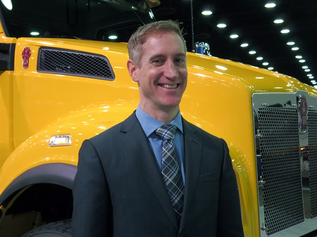 Patrick Dean, Kenworth chief engineer, with the new Kenworth T880S.