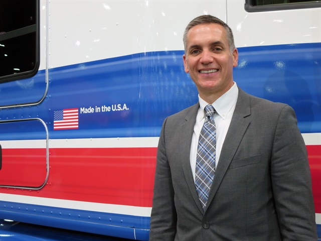 Mike Dozier, Kenworth general manager, with the T680 Advantage  driver