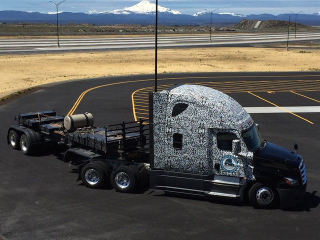 Trucks under development, like this camouflaged rig, will be put