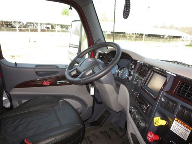 This is a show truck, and the posh interior includes leather-covered