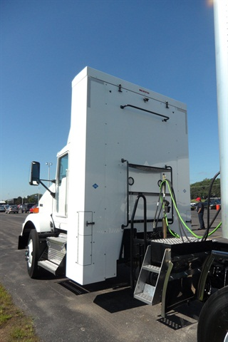 This tall cabinet behind the Kenworth T800's cab houses four