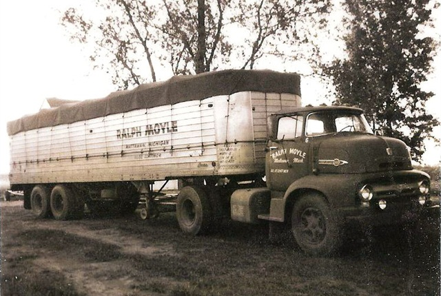 This is the second tractor-trailer Ralph owned, a 1956 C600 Ford with an open-top trailer.This tractor was used to haul grapes, apples, Christmas trees and pickles. It traveled as far away as Iowa from its home in Mattawan, Mich.