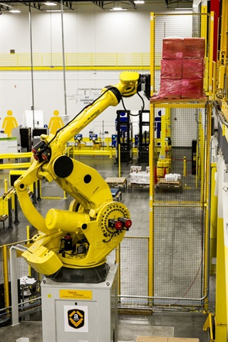 Robots and information technology are transforming the way warehouses and fulfillment centers work. Photo: Amazon
