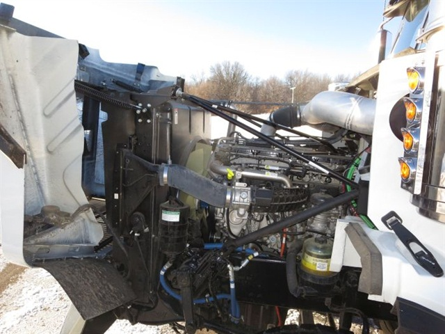 Turbo-compounding helps the big DD16 make big power, but it had to use many of the automated transmission's 18 ratios and work hard to move the heavy, multi-axle rig.