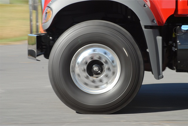 True rotation of a several-hundred-pound mass and high speeds requires balancing, not just of the tire, but the entire rotating mass, including the hub, brake drum, wheel and tire.