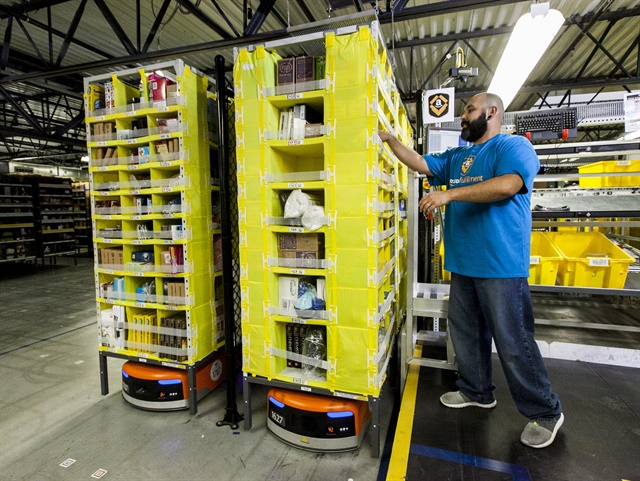 Amazon has been using these small orange warehouse robots for several years to make picking much faster, increasing their number every year. Photo: Amazon