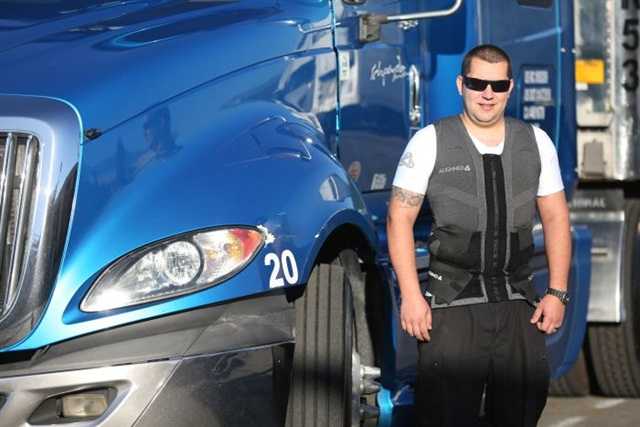 Dawid Szpojda, president of Schpoyda Trucking, wearing an Alignmed SpinalQ posture garment, which he credits with maintaining good posture on cross-country hauls.