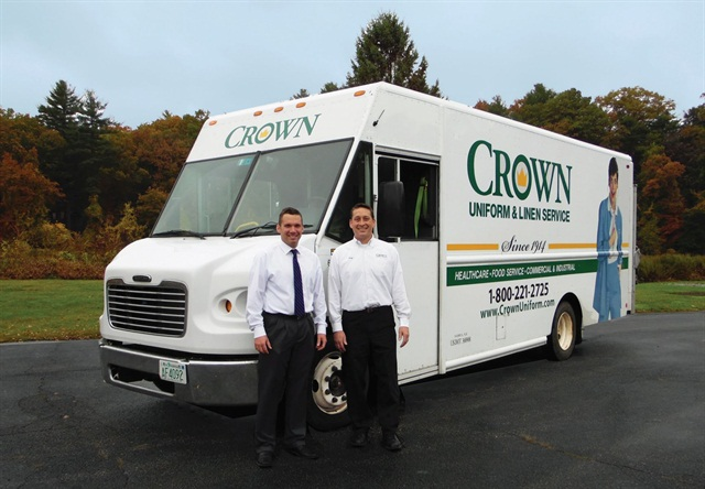 Dave Hardy, Crown's fleet supervisor, (left) stands with Greg Franklin, a service manager, in front of a Crown Freightliner step van. Crown's fleet has reduced its daily idling time from 70 minutes per driver down to 7 minutes.
