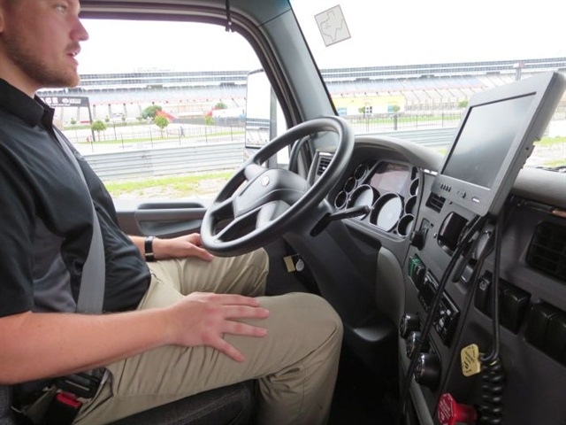 "Peterbilt demonstrates its ""advanced driver assist systems,"" the truck navigating a road course with no help from the driver at the Texas Motor Speedway. Photo: Deborah Lockridge"