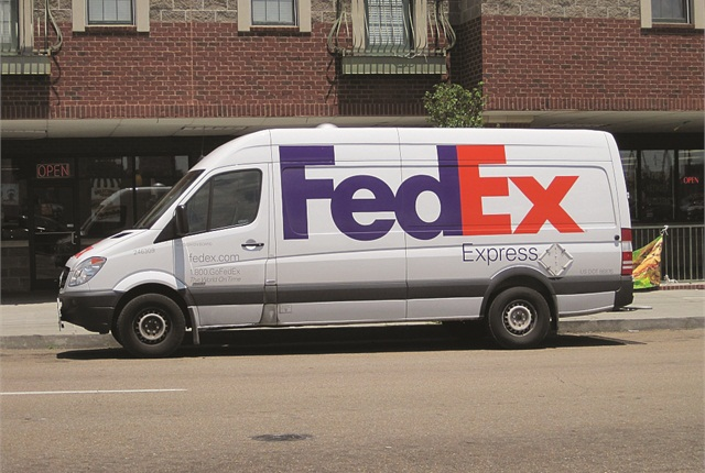 In addition to electric and hybrid-electric equipment, FedEx is saving fuel and GHG emissions by replacing older trucks with smaller, more fuel-efficient vans like this Sprinter.