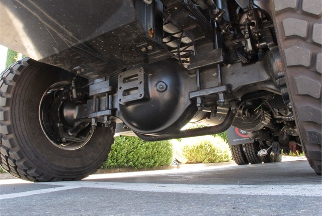 The driving steer axle gets the 122SD through spots that would stop a tandem drive in its tracks.