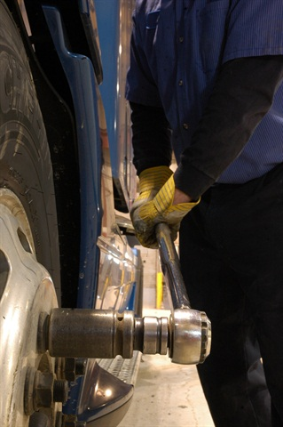 A calibrated torque wrench is required to set the recommended torque on wheel fasteners. Over-torqueing with an impact wrench can stretch and weaken the studs.