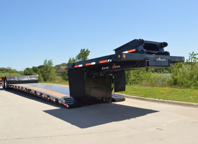 Low deck heights, as on XL Specialized's XL 80, allow carrying of extra-high loads. The hydraulic mechanism on this trailer's removable gooseneck is powered by 13-hp Honda engine. In other systems, a tractor's PTO runs a pump to supply hydraulic pressure. Photo:  XL Specialized