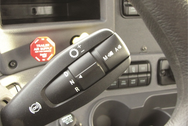 Stubby selector lets driver chooseAutomatic or Manual modes and command up- or down-shifts.  But most of the time he can just slip it in D and drive.