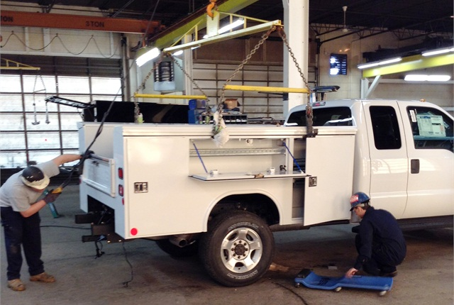 Workers at Reading Group install a utility body on a Ford SuperDuty chassis. Upfitters must meetnumerous Federal Motor Vehicle Safety Standards and then certify compliance.