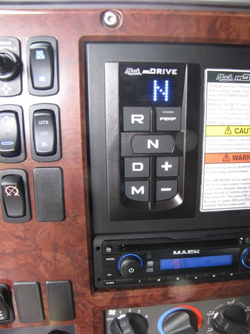 This Mack Pinnacle tractor's mDrive transmission has a keypad selector on the dash. A lever type is optional.
