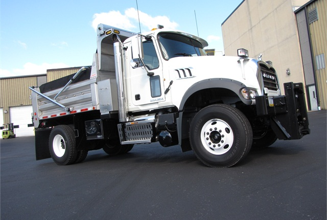 The single rear axle allows Class 7 ratings, but this one's decidedly Class 8, with axles totaling 44,000 pounds in capacity. The steer axle is set forward to better handle weight of the plow mount and, when it snows, a long steel blade.