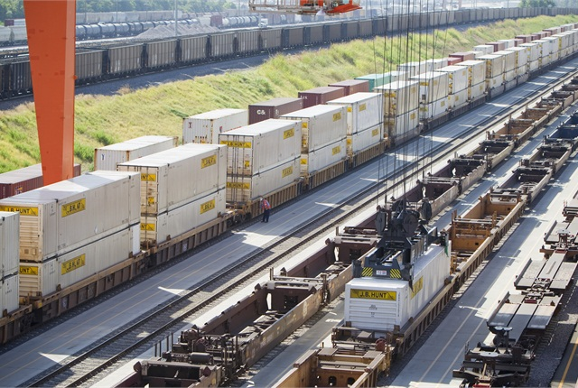 Part of J.B. Hunt's green strategy involves converting some long-haul freight movement to intermodal.