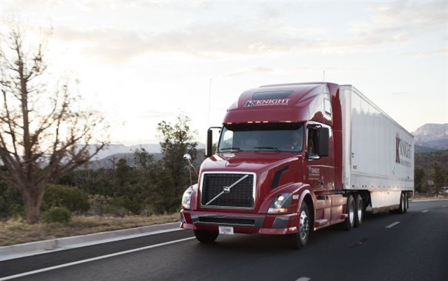 Knight Transportation controls road speeds and has shortened tractor-trailer gaps to cut fuel use, and a solar farm helps power its Phoenix HQ.