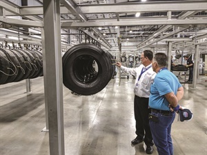 Larry Lafreniere, Houston sales manager for Beasley Tire Service, explains the retreading process to one of its customers at the grand opening celebration for the company's 36,000-square-foot retread plant. Photo: Beasley Tire Service