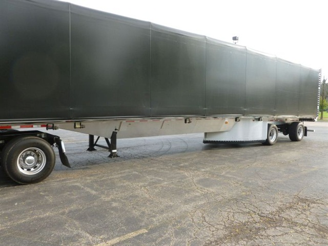 The custom aluminum trailer under-belly includes a V-shaped hull design that intersects with an air diverter at the first trailer axle.