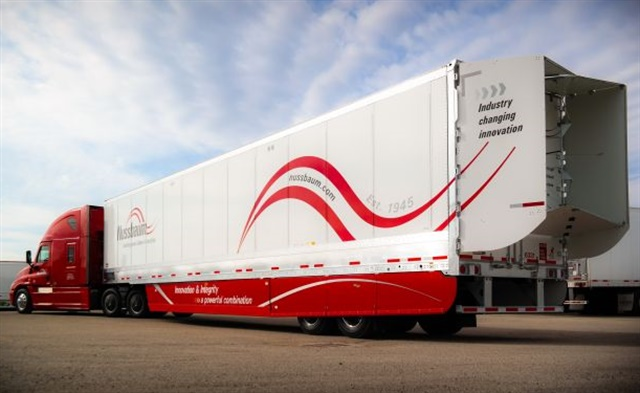 "This trailer owned by Illinois-based Nussbaum Transportation has both an aerodynamic ""boat tail"" from Stemco TrailerTails and extra-long trailer side fairings it developed with Wabash. Photo: Nussbaum Transportation"