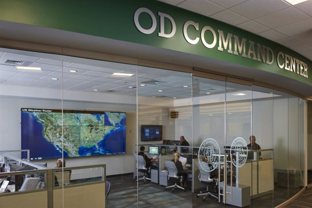 Data from PeopleNet units on trucks plus external information, like weather reports, generate graphics on the big wall map. Dispatchers can see it all from their nearby work stations. Photo via Old Dominion Freight Line