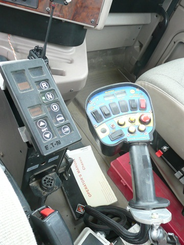 This concrete truck's vocational-type Eaton UltraShift Plus transmission has a keypad selector mounted to the driver's right. The colorful paddle device has controls for the mixer drum.