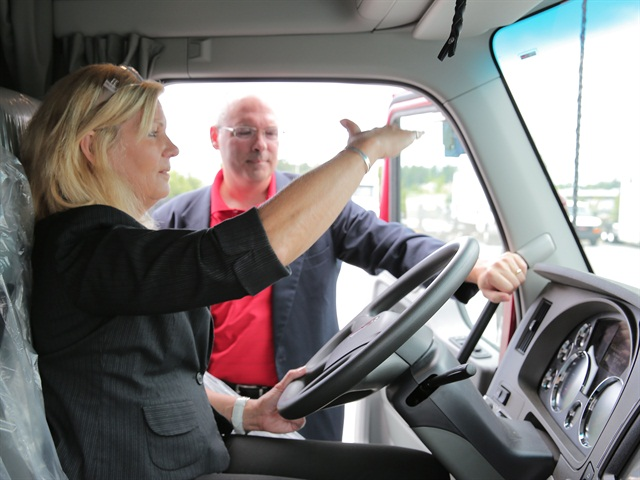 Ellen Voie, president of the Women in Trucking association, checks out a new custom spec from Ryder designed for women drivers.