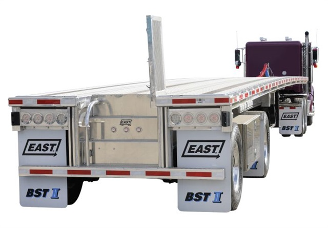 This integrated stairway from East makes for an easy and safe climb onto a flatbed's deck. Cover plate lifts up and locks, and includes an above-deck grab handle. A curving handle is on the stairway's left wall. The cover plate includes a housing for center ID lamps that are legally horizontal when the cover plate is folded back down. Photo: East Manufacturing