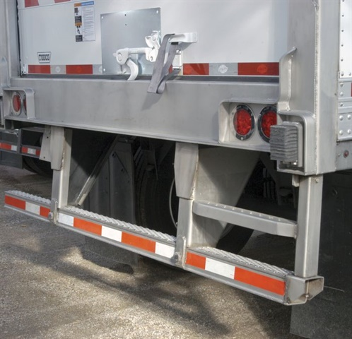 This step built into the rear impact guard of a Utility trailer adds a riser above the bumper. This trailer also has a handle adjacent to the swing door. Photos: Utility Trailer Mfg.