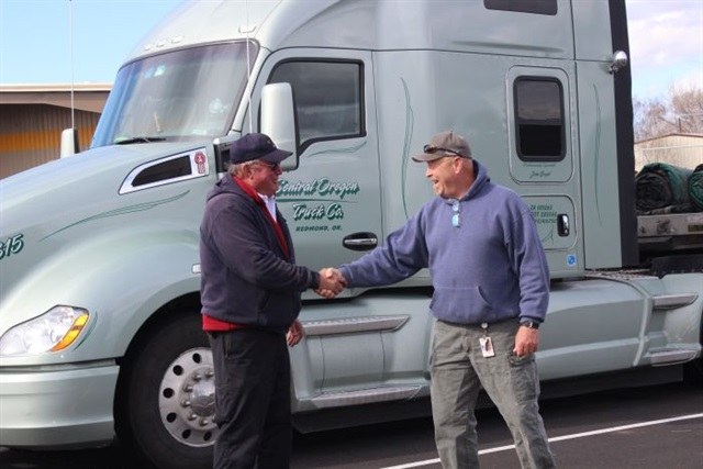 Central Oregon Trucking Co. maintenance concierge Mike Gillespie (left) greets a driver returning from a long trip to the flatbed carrier's terminal. Photo: Central Oregon Trucking Co.