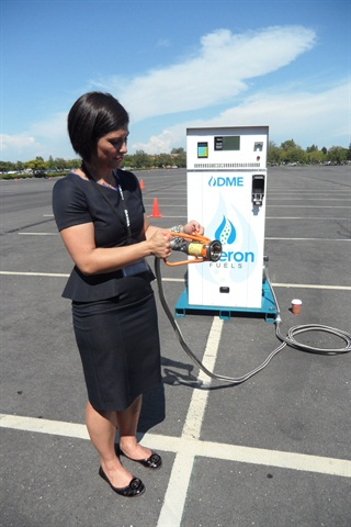 Rebecca Boudreaux, president of Oberon Fuels, shows a 21-gallon-per-minute dispenser. The nozzle twists onto avehicle's filler neck.