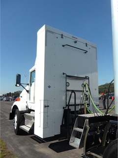 "This tall cabinet behind the Kenworth T800's cab houses four ""bottles"" that carry CNG for the Cummins Westport spark-ignited 11.9-liter engine."