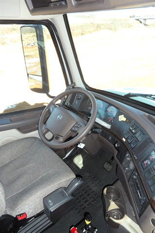 Trucks equipped with automated manual transmissions, like this Volvo VHD, have a lever or push-button shift selector but no clutch pedal, because the clutch is automated, like the transmission.