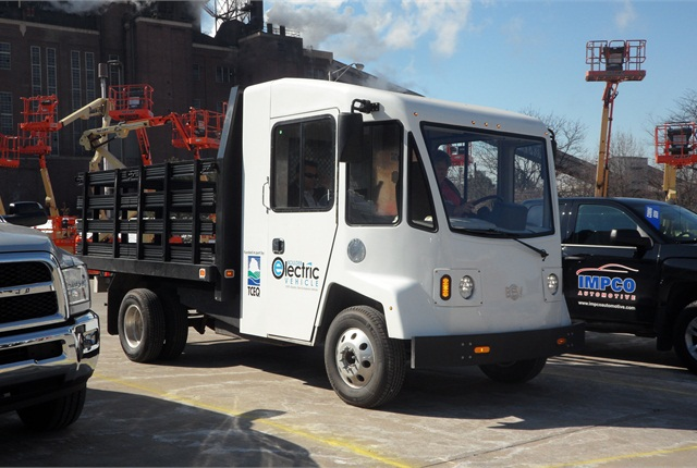 The Boulder EV's bulbous cab contrasts with more conventional-looking trucks at NTEA event. The cab is made of lightweight composite materials and is roomy inside. The driver sits close to the windshield and slightly ahead of the side doors. On the dash is a rotary switch marked R-N-D, and a handbrake is used for parking.